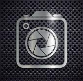 stock photo of megapixel  - Icon of metal camera on a gray background - JPG