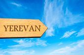 image of armenia  - Wooden arrow sign pointing destination YEREVAN ARMENIA against clear blue sky with copy space available - JPG
