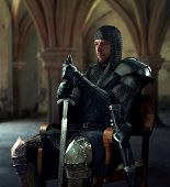 pic of palace  - Ancient knight in metal armor sitting on a wooden chair in a palace - JPG