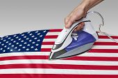 stock photo of iron star  - Steam iron for smooth out the wrinkles of Flag - JPG