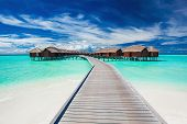 pic of jetties  - Overwater villas on the tropical lagoon connected to island by jetty - JPG