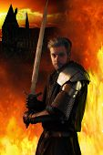 pic of fiery  - Ancient knight in metal armor with sword on a fiery background - JPG