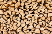 pic of firewood  - Background of chopped firewood stacked up on top of each other in a pile - JPG