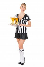 foto of referee  - Young Beautiful Female Referee Holding Tray With Beer Over White Background - JPG