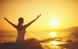 picture of sea life  - yoga at sunset on the beach - JPG