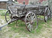 stock photo of ox wagon  - an old wagon abandoned on the trail - JPG