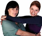 stock photo of mother law  - Shot of young woman hugging her mother-in-law