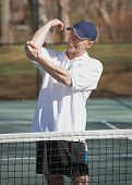 image of tennis elbow  - Man in pain with elbow sports inquiry on tennis court - JPG