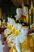 stock photo of samadhi  - buddha statues in a row yangon myanmar - JPG