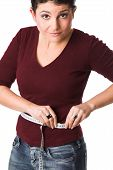 stock photo of tape-measure  - pretty brunette measuring her waistline with a tape measure - JPG