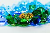 Gold Diamond Place Inside Green Diamonds And Blue Diamonds poster