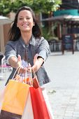 dark-haired lady with shopping bags