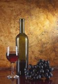 pic of wine-glass  - glass of red wine and bottle against the background of the old wall - JPG