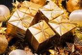 Luxury Gold Themed Holiday Greeting Card with Gift Boxes on Festive Background , Beautiful Christmas poster