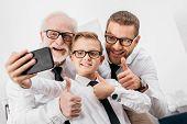 Family In Formal Wear Taking Selfie poster