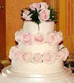 picture of three tier  - three tiered wedding cake covered in pink roses - JPG