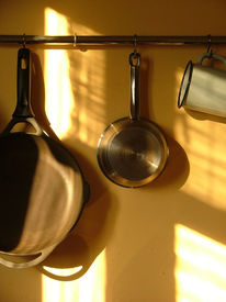stock photo of kitchen utensils  - kitchen supplies hanging on the wall - JPG