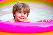 Children Playing In Pool. Children Playing And Active Leisure - Swimming Pool Concept. Kids Happy. C poster