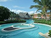 stock photo of greater antilles  - holiday resort with pool at the Dominican Republic a island of Hispanola wich is a part of the Greater Antilles archipelago in the Carribean region - JPG