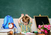 Schoolboy. Kid Enjoy Learning. Elementary School Student Write At Workplace. Cute Child Boy Doing Ho poster