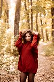 Happy Girl On Autumn Walk. Beautiful Happy Smiling Girl With Long Hair Wearing Stylish Jacket Posing poster