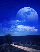Landscape Of Beautiful Moon With Many Stars And Clouds. Super Moon Behind Partial Cloudy. Serenity B poster