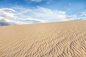 Desert Sand Dune Nature Background. Desert Sand Dune Background With Ripples Caused Wind Erosion And poster