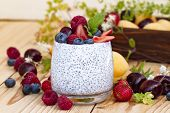 Chia Seed Pudding With Berries On Wooden Table. Rustic Stile Healthy Breakfast. Chia Seed With Milk, poster