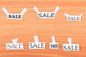 Pieces of paper with the words SALE