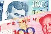 A Blue One Hundred Serbian Dinar Bank Note, Close Up In Macro With A Red, Chinese Renminbi One Hundr poster