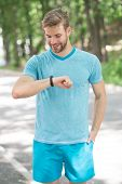 Best For Training. Sportsman Tracking His Training With A Sports Watch. Handsome Athlete Using Smart poster