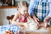Kid Is Making Dough. Family Is Cooking In Kitchen. Child Is Baking Homemade Pastries Or Pizza. Child poster