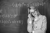 Teacher On School Lesson At Blackboard. Woman In Classroom. School. Home Schooling. Serious Woman. B poster