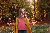 Autumn Forest Leisure. Portrait Of Peaceful Girl Meditating With Eyes Closed In Fall Nature Park. Tr poster