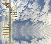 picture of stairway to heaven  - Blue sky relfected in water with spiral stairway to heaven glowing - JPG