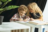 Boy And Girl Preparing For School After A Long Summer Break. Back To School. Little Caucasian Models poster