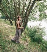 Young Hippie Woman Standing Near Forest Lake poster