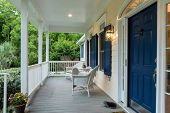 Beautiful front entrance of Southern home with covered porch. poster