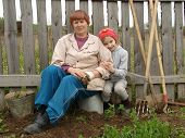 picture of household farm  - little girl with grandmother at the rural farm - JPG