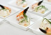 pic of craw  - many pieces of marinated craw claw on white plates - JPG