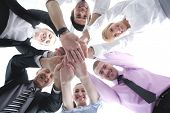 business people group joining hands and representing concept of friendship and teamwork,  low angle