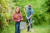 Planting Flowers. Family Dad And Daughter Planting Plants. Transplanting Vegetables From Nursery Gar poster