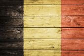 flemish flag on wood texture background