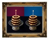 stock photo of nack  - Chocolate birthday party nacked cake with vanilla cream and burning candle on antique ceramic stand with blue pattern purple background dark blue tablecloth golden antique carved picture frame isolated on white background - JPG
