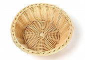 Empty wicker basket on a white background