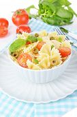 Delicious pasta with tomatoes on plate on table close-up