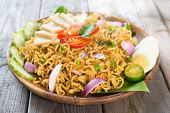 foto of malaysian food  - Malaysian style maggi goreng mamak  or spicy fried curry instant noodles - JPG