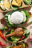 Popular Indonesian local food nasi ayam penyet, indonesian fried chicken rice. Fresh hot with steam
