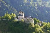 ancient castle in forest mountains of Italian alp