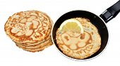 picture of tuesday  - Freshly made pancakes with lemon and frying pan - JPG